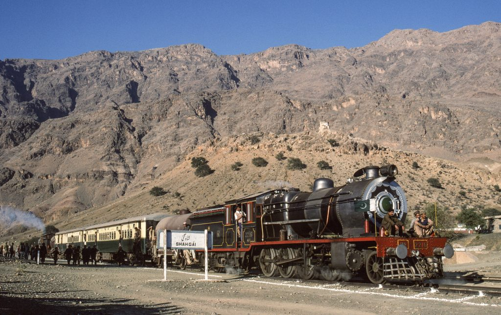 Broad gauge, oil fired steam locomotive, class HGS 2-8-0 2216, with 2264 at the rear, prepare for a runpast with a charter train at Shahgai, on the Khyber Pass, 23rd December 1993.